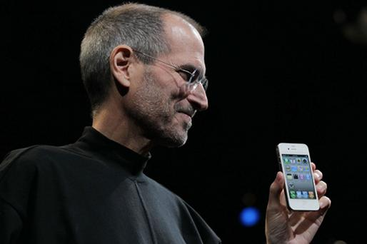 Apple CEO Steve Jobs holds up the new iPhone 4 during the Apple Worldwide Developers Conference in 2010. Photo: Getty Images