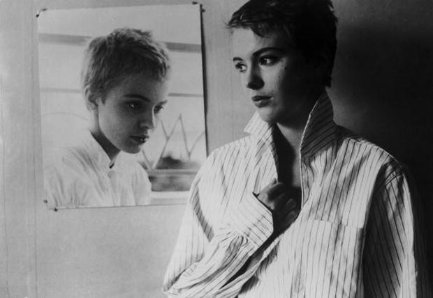 American actress Jean Seberg (1938 - 1979) by a photograph of herself in a publicity still for 'A Bout De Souffle' ('Breathless'), directed by Jean-Luc Godard, 1960. (Photo by Hulton Archive/Getty Images)
