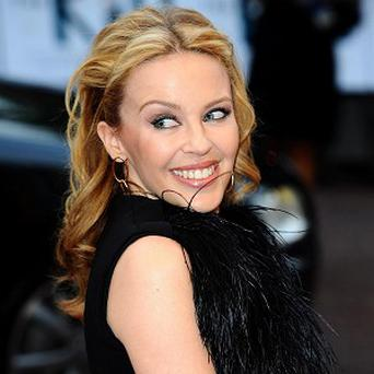 Kylie Minogue who has revealed that she could adopt or use a surrogate mother