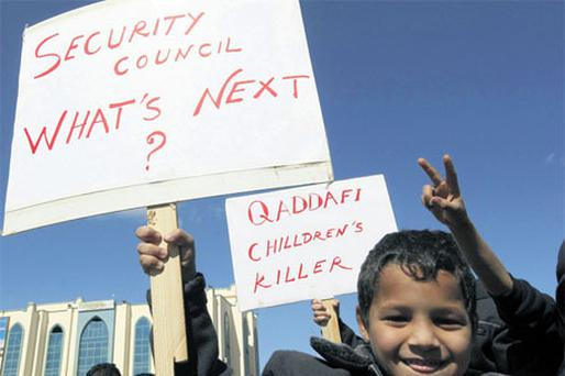 A young boy takes part in a protest against Gaddafi in Tobruk, Libya, yesterday