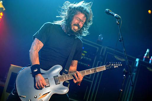 Dave Grohl of Foo Fighters performing on stage during the 2011 NME Awards. Photo: PA
