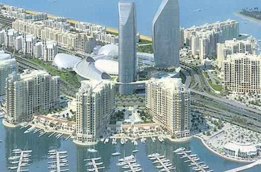 The marina residences at 'The Palm Jumeirah' development, also known as Palm Island, in Dubai. Builders have returned to complete projects in the desert kingdom