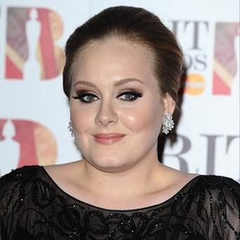 Adele doesn't count herself as a singing legend