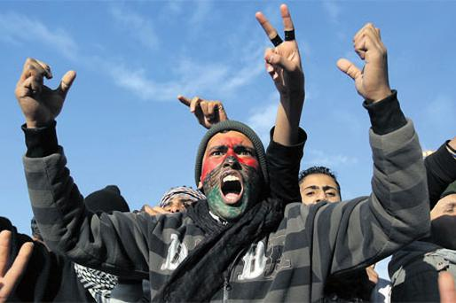 Opposition demonstrators demand the removal of Libyan leader Muammar Gaddafi in Benghazi yesterday