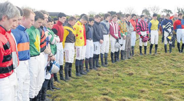 Jockeys in action at Knockanard observe a minute's silence for Jack Tyner