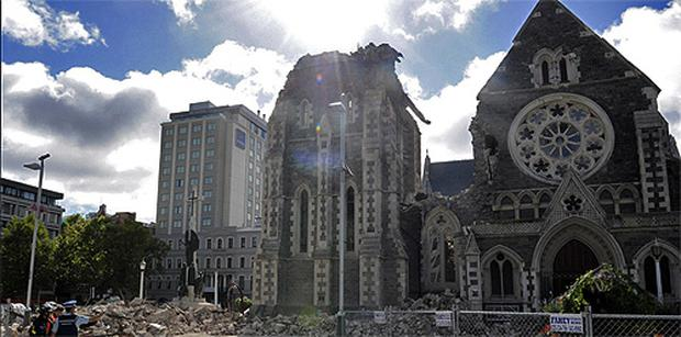 Police and search and recovery team members assess damage of the Christchurch Cathedral. Photo: AP