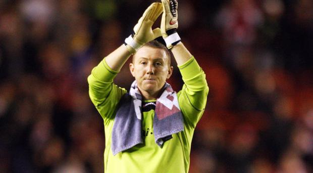 Queens Park Rangers goalkeeper Paddy Kenny applauds the fans after the final whistle. Photo: PA