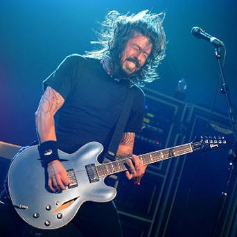 Dave Grohl of Foo Fighters performing on stage during the 2011 NME Awards at the O2 Academy Brixton, London