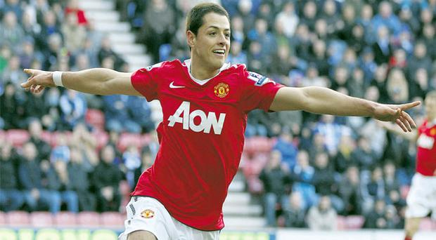 Manchester United's Javier Hernandez celebrates opening the scoring in his side's comfortable victory at Wigan yesterday.