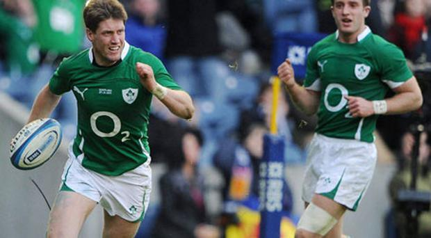 Ronan O'Gara sprints for the line to score Ireland's third try against Scotland. Photo: Stephen McCarthy / Sportsfile
