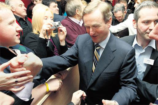 Fine Gael leader Enda Kenny is greeted by well-wishers in his home town of Castlebar, Co Mayo, on Saturday night