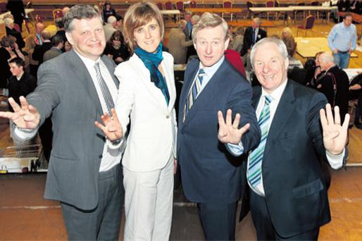 Fine Gael TDs John O'Mahony, Michelle Mulherin, Enda Kenny and Michael Ring hold up four fingers at the count centre in Castlebar to show the party's immense achievement in capturing four of the five seats in Mayo