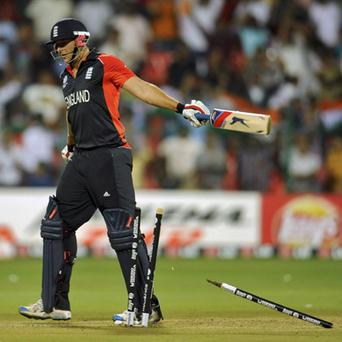 Tim Bresnan reacts after being bowled in the dying overs of England's run chase in Bangalore yesterday. Photo: Reuters
