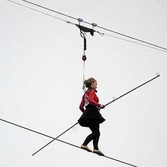 Helen Skelton walks on a tightrope between two of the chimneys at Battersea Power Station
