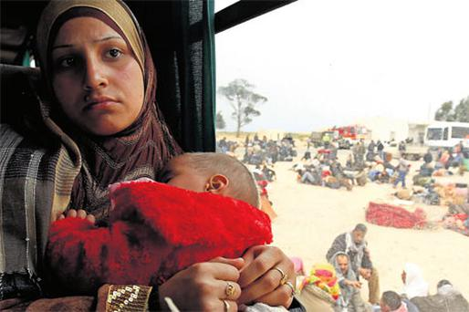 An Egyptian mother and child on a bus at a refugee camp near the Libyan and Tunisian border crossing of Ras Jdir after fleeing unrest in Libya