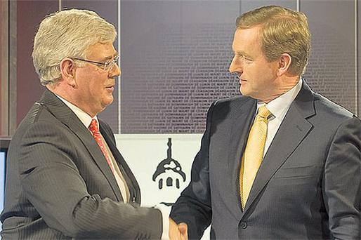 Labour's Eamon Gilmore and Fine Gael's Enda Kenny have begun talks on forming a coalition government