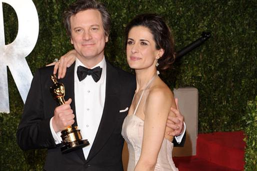 Colin Firth holds his Oscar for best actor for his role in 'The King's Speech' as he arrives with wife Livia Giuggioli at the 2011 Vanity Fair Oscar party. Photo: Getty Images
