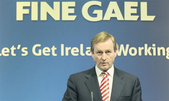 Fine Gael leader Enda Kenny promises to unveil a new budget within 100 days of taking office