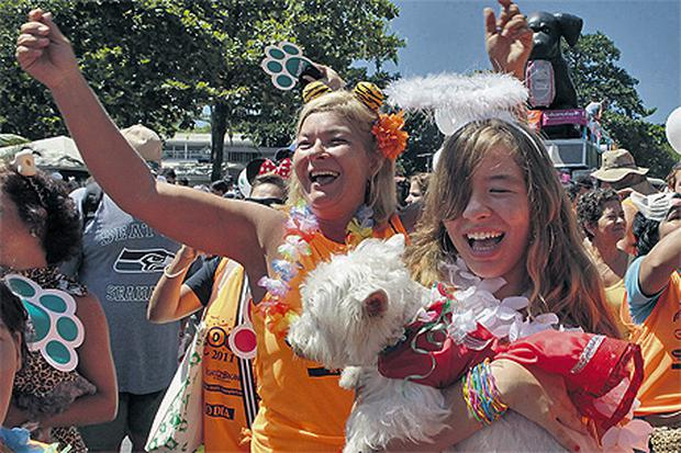 Carnival revellers celebrate with their dogs during the Blocao or