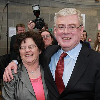 Labour Party leader Eamon Gilmore is hugged by his wife Carol at the count centre at Dun Laoghaire at Loughlinstown Leisure Centre, Dublin