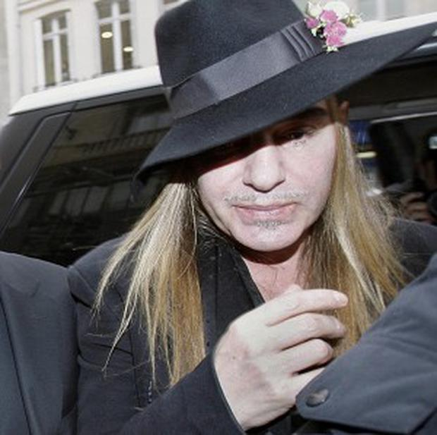Fashion designer John Galliano arrives at a police station in Paris
