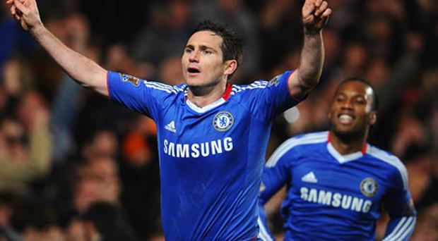 Frank Lampard points towards the sky as he celebrates after scoring Chelsea's winning goal from the penalty spot against Manchester United at Stamford Bridge last night. Photo: Getty Images