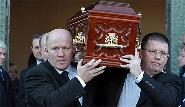 Michael Carruth and his brother Austin carrying the coffin of their father Austin