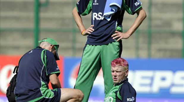 Ireland's Kevin O'Brien receives some medical attention during the ICC Cricket World Cup match at the at M Chinnaswamy Stadium. Photo: PA