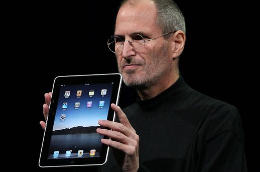 Apple chief executive Steve Jobs poses with the Apple iPad. Photo: Getty Images