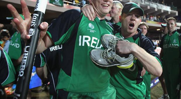 Man of the Match Kevin O'Brien (left) celebrates with brother Niall after Ireland's victory over England in the 2011 ICC World Cup Group B clash in Bangalore yesterday. Photo: Getty Images