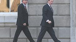 Fine Gael's Enda Kenny arrives at Leinster House yesterday for talks on the formation of a coalition government
