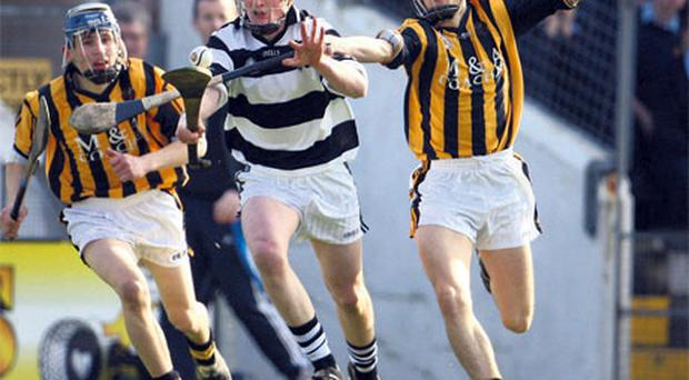 Robert Moran, left, and Eoin Brennan of Castlecomer CS, in action against St Kieran's College's Diarmuid Cody during the Leinster Colleges Senior Hurling Championship final at Nowlan Park yesterday. Photo: Ken Sutton / Sportsfile