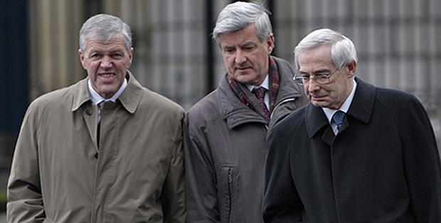 Arriving for a meeting of the Oireachtas Joint Committee on Economic Regulatory Affairs at Leinster House were, from left, Central Bank principals Tony Grimes, Tom O'Connell, and former governor of the Central Bank John Hurley