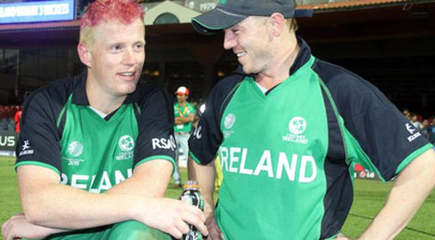 Ireland Kevin O'Brien, left, who hit the quickest hundred in World Cup history, takes a quiet moment with his brother Niall to enjoy their record-breaking victory over England on Wednesday in Bangalore