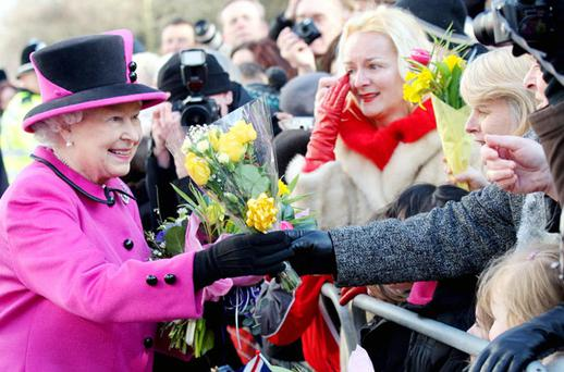 The Queen she is to call on us...Queen Elizabeth is to make an official visit here in the summer – the first by a British monarch since the foundation of the State. A date has not been released but it is widely expected to be in May – a few weeks after the wedding of Prince William and Kate Middleton. Our picture shows the queen during a visit to Leamington Spa, Warwickshire, yesterday. Photo: PA