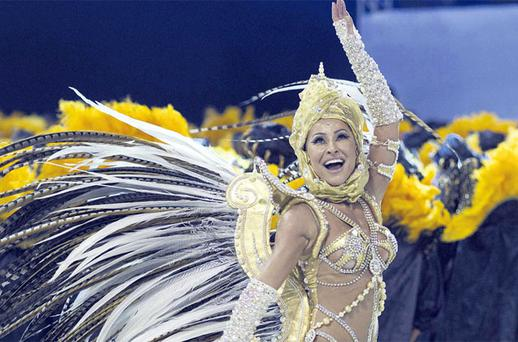 Brazilian comedian Sabrina Sato performing during the parade in Sao Paulo, Brazil, yesterday as one of the world's biggest carnivals went ahead despite fears it would be cancelled after a a fire destroyed thousands of costumes last month. PHOTO: AP /ANDRE PENNER