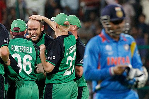 Ireland's Trent Johnston (2nd L) celebrates the wicket of India's Virender Sehwag with team mates during their World Cup group B match in Bangalore
