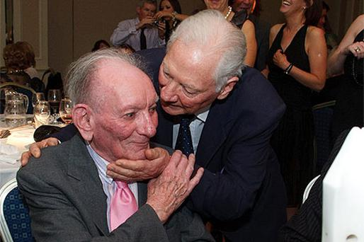 Gay Byrne congratulates Brian Friel at the Donegal Association dinner in the writer's honour at the Burlington Hotel