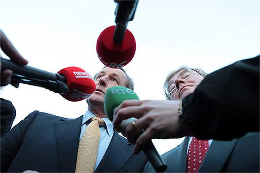 Coalition party leaders Enda Kenny and Eamon Gilmore answer reporters' questions as they announce the conclusion of negotiations on a deal for government yesterday