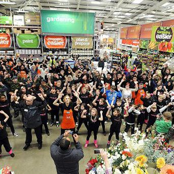 A huge group of staff and shoppers take part in a flash mob dance at the Beckton B and Q store
