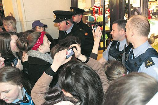 Gardai are called in to deal with Justin Bieber fans hoping to meet their hero as they gather outside Tommy Hilfiger in Grafton Street, Dublin, yesterday