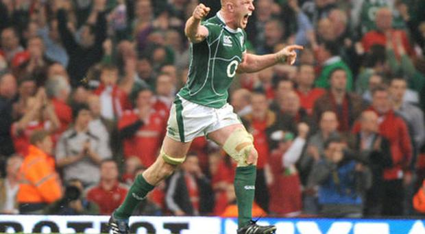 Paul O'Connell celebrates at the end of Ireland's victory against Wales which secured the Grand Slam in 2009.