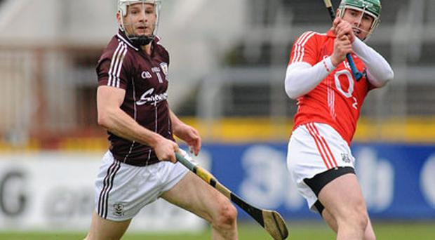 Cork's Brian Murphy in action against Galway's Andy Smith in front of a small crowd at Pairc Ui Chaoimh on Sunday.