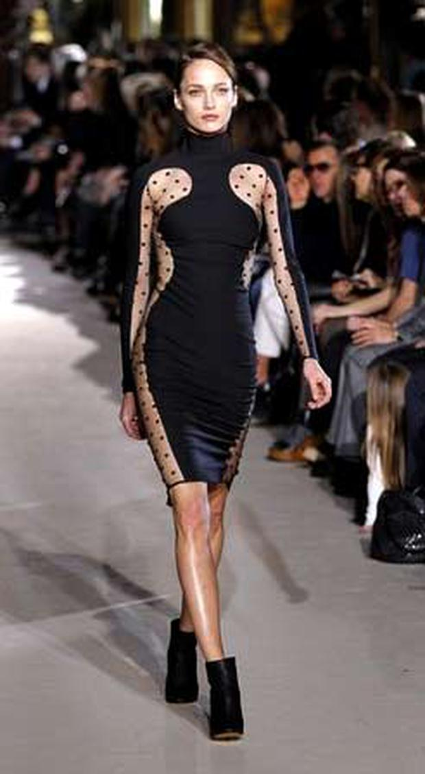 A form-fitting dress sculpted to the body in black, bisected with panels of see-through point d'esprit by Stella McCartney during Paris fashion week. Photo: Getty Images