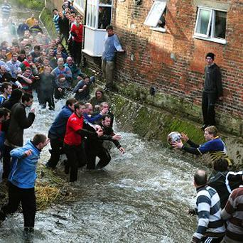 The traditional Shrovetide game sees players attempt to score in goals three miles apart