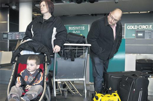 Two-year-old Liam Heffernan at Dublin Airport yesterday with his parents Mary and Tony before departing for New York