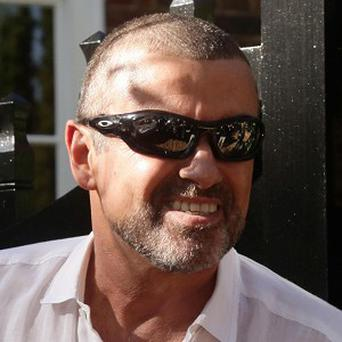 George Michael called a TV show to deny a story that he had split from partner Kenny Goss
