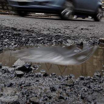 Romanian president Traian Basescu has advised people to see his country from the air due to potholed roads