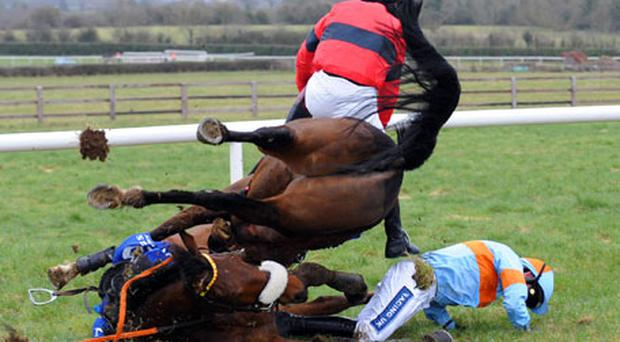 Ruby Walsh (blue and orange colours) takes a crashing fall from King Of The Refs at the last in the Maiden Hurdle at Naas yesterday bringing down Boro Dee and Paul Townend in the process. Both jockeys escaped serious injury although Walsh suffered a cut under his eye. Photo: Healy Racing