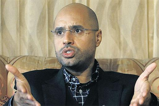 Libyan leader Muammar Gaddafi's most prominent son, Saif al-Islam, gives an interview in Tripoli yesterday as his troops continue efforts to crush a popular rebellion